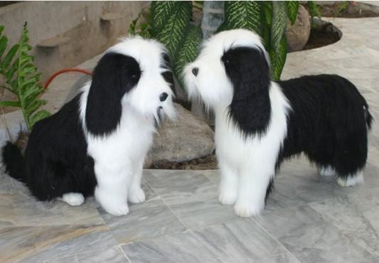 Мягкая игрушка собака Hansa Овчарка сидящая искусственный мех белый черный 75 см