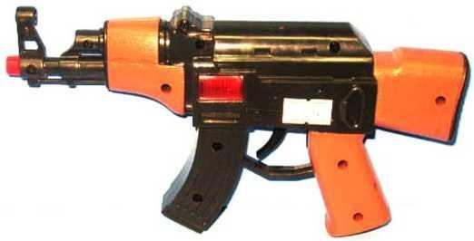 Автомат-трещетка Наша Игрушка трещотка черный оранжевый 2804
